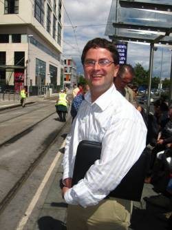 Main organizer and project coordinator Kevin Harrington at a tram stop in Tallaght